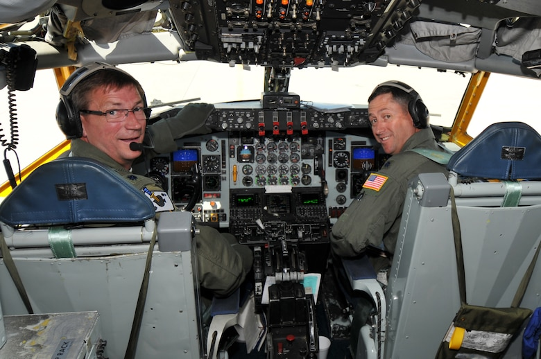 Lt. Col. Dale Storr (left) and Lt. Col. Michael Spencer prepare to take off in a KC-135 Stratotanker at the Spokane International Airport. This was Lt. Col. Storr's final military flight before retiring from the 141st Air Refueling Wing. (U.S. Air Force photo by Staff Sgt. Anthony Ennamorato)