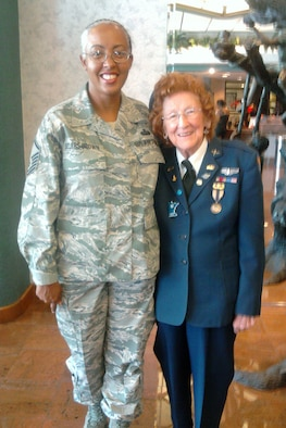 Master Sgt. Bianca Sellers-Brown, who is the noncommissioned officer in charge of the commander's support staff for the 307th Mission Support Group, and Mrs. Elizabeth Strohfus, pose for a photo at the 2011 Commemorative Air Force Air Show in Odessa, Texas, Oct. 7, 2011. In August 1943, Strohfus, who is now 91 years old, was selected to participate in a women's flight program freeing men pilots to report for military duty overseas. These women were officially designated as WASPs, Women Airforce Service Pilots. Sellers-Brown was selected as a military escort for Mrs. Strohfus for the air show. (Courtesy photo)