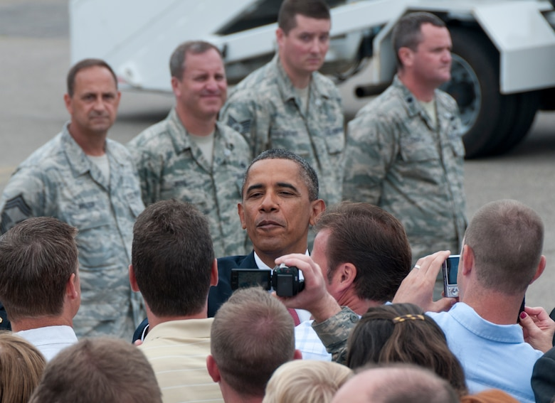 President Barack Obama greets well-wishers as he steps off Air Force One on the ramp of the 133rd Airlift Wing at the Minneapolis-St. Paul International Airport on August 30, 2011. The president is in the Twin Cities to deliver a speech to the American Legion Annual Conference. The visit is heavily supported with security, logistics, media and other support by the Airmen of the 133rd Airlift Wing. USAF official photo by Senior Master Sgt. Mark Moss