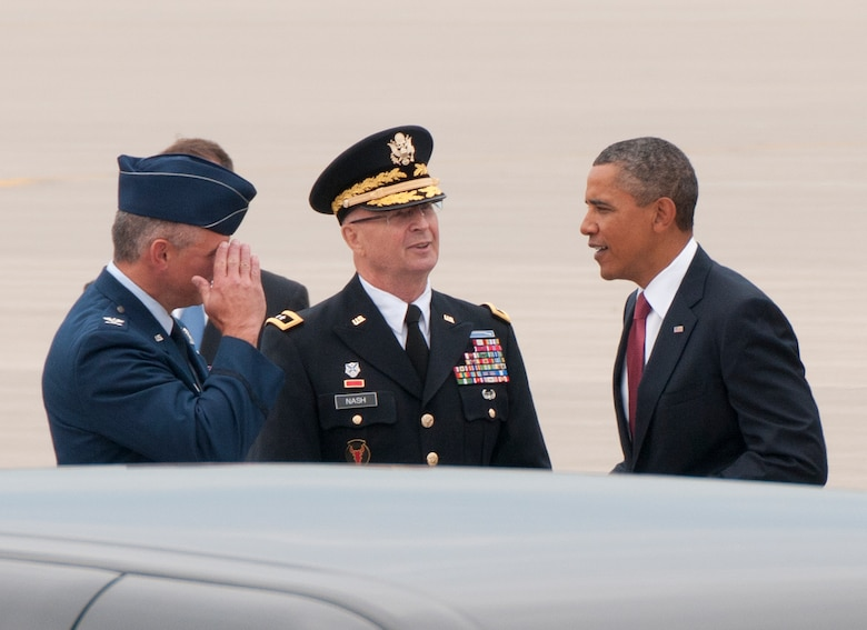 The commander-in-chief, President Barack Obama, is greeted as he steps off Air Force One by Maj. Gen Rick Nash, Minnesota's Adjutant General (center) and Col. Greg Haase, commander of the 133rd Airlift Wing on the ramp of the 133rd Airlift Wing at the Minneapolis-St. Paul International Airport on August 30, 2011. The president is in the Twin Cities where he delivered a speech to the American Legion Annual Conference. The visit is heavily supported with security, logistics, media and other support by the Airmen of the 133rd Airlift Wing. USAF official photo by Senior Master Sgt. Mark Moss