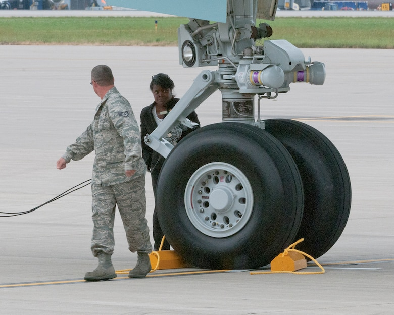 Staff Sgt. Patrick Koss of the 133rd Aircraft Maintenance Squadron checks the chocks he just placed under the wheel of Air Force One on the ramp of the 133rd Airlift Wing at the Minneapolis-St. Paul International Airport on August 30, 2011. The VC-25A, which is a highly customized Boeing 747-200B, arrived at the Minnesota Air National Guard base bringing President Barack Obama, the commander-in-chief, to the Twin Cities where he delivered a speech to the American Legion Annual Conference. The visit is heavily supported with security, logistics, media and other support by the Airmen of the 133rd Airlift Wing. USAF official photo by Senior Master Sgt. Mark Moss