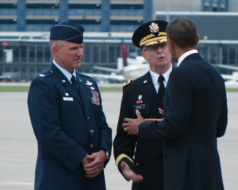 The commander-in-chief, President Barack Obama, takes a moment to talk with Maj. Gen. Rick Nash, Minnesota's Adjutant General (center) and Col. Greg Haase, commander of the 133rd Airlift Wing as he steps off Air Force One on the ramp of the 133rd Airlift Wing at the Minneapolis-St. Paul International Airport on August 30, 2011. The president is in the Twin Cities where he delivered a speech to the American Legion Annual Conference. The visit is heavily supported with security, logistics, media and other support by the Airmen of the 133rd Airlift Wing. USAF official photo by Master Sgt. David Fenner