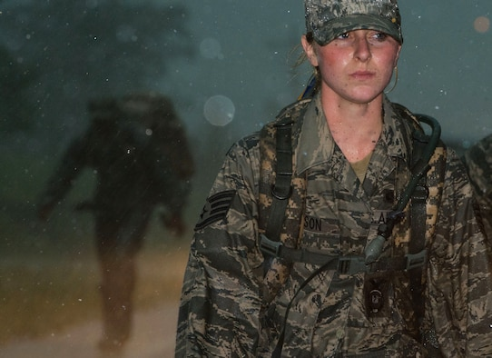 Staff Sgt. Deanna Dickson, a 192nd Security Forces Squadron patrolman, endures wind and rain during the Security Forces 9/11 Ruck March to Remember in Greenwood, Va., Aug. 25, 2011. Security forces squadrons from multiple bases are conducting a relay ruck march from San Antonio, Texas, to Ground Zero in New York City. The 192nd SFS is part of the Virginia Air National Guard. (U.S. Air Force photo/Tech. Sgt. Barry Loo)