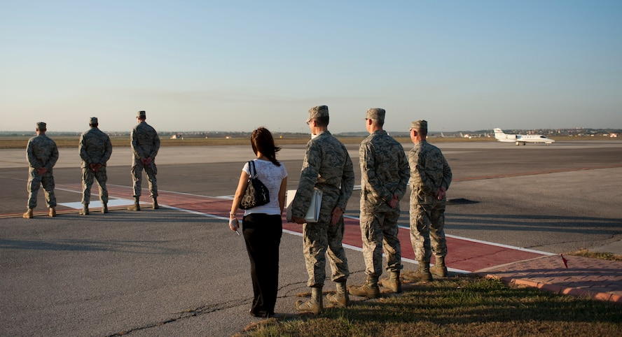 The 39th Air Base Wing leadership and protocol office await the arrival of a distinguished visitor Aug. 24, 2011, at Incirlik Air Base, Turkey. (U.S. Air Force photo by Airman 1st Class Clayton Lenhardt/Released)