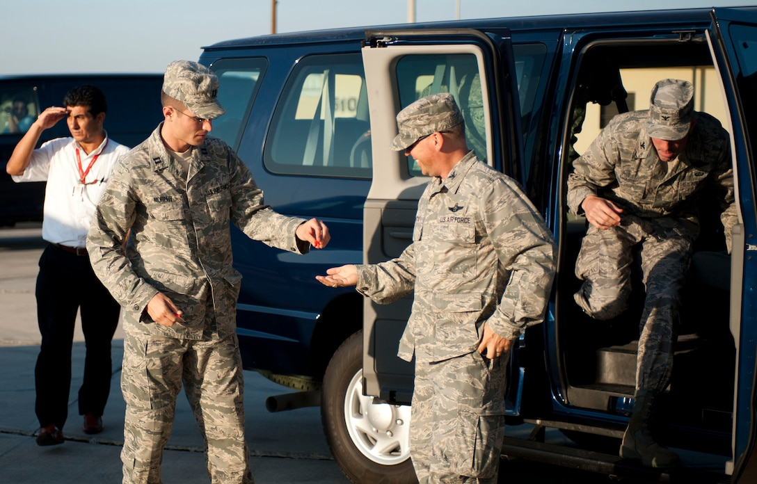 Capt. Jonathan Murphy, 39th Air Base Wing chief of protocol, hands ear plugs to Col. Chad Butts, 39th Air Base Wing vice commander, before greeting a distinguished visitor Aug. 24, 2011, on the flightline at Incirlik Air Base, Turkey. (U.S. Air Force photo by Airman 1st Class Clayton Lenhardt/Released)