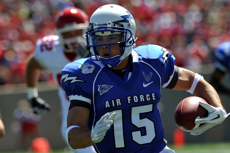 Air Force wide receiver Jonathan Warzeka breaks into the open field during the Falcons' game versus South Dakota at Falcon Stadium Sept. 3, 2011. Warzeka, a native of Lake Elsinore, Calif., had one reception for 22 yards and one rush for 9 yards. (U.S. Air Force photo/Raymond McCoy)