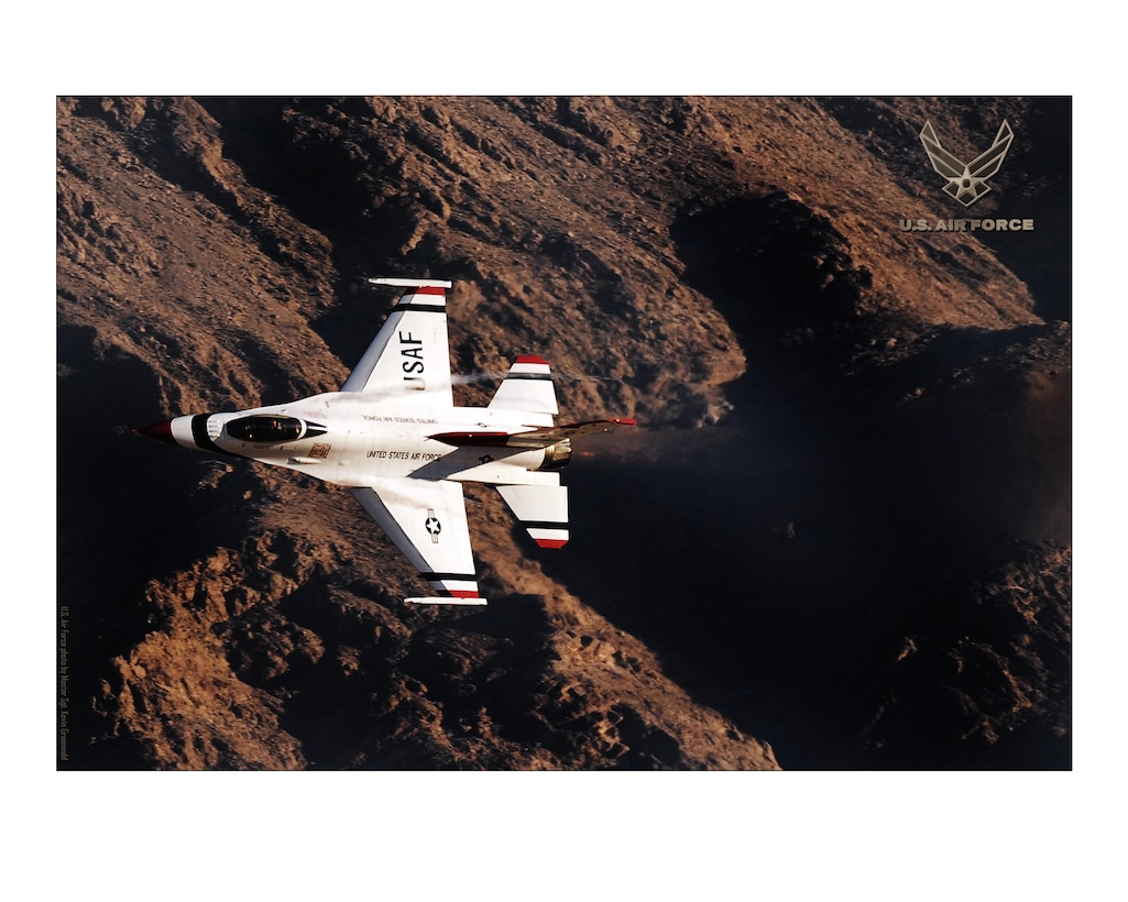A U.S. Air Force Air Demonstration Squadron Thunderbird F-16 Fighting Falcon flies over Nellis Air Force Base, Nev. 24X30 inches @ 300 PPI (U.S. Air Force photo/layout by Master Sgt. Kevin J. Gruenwald/Released)