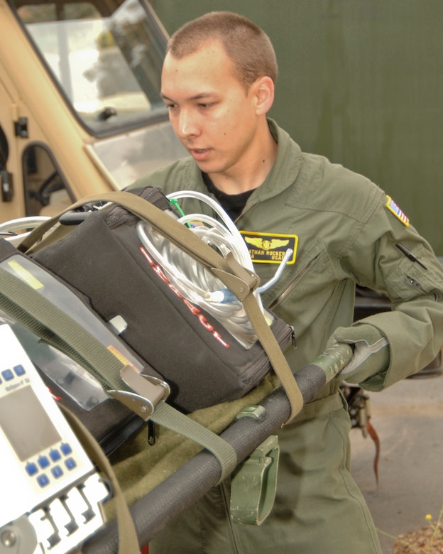 Senior Airman Nathan Rucker prepares to load a litter into a transport for a training exercise used by the 146th Aeromedical Evacuation Squadron at the 146th Airlift Wing Port Hueneme, Calif. August 10, 2011. Senior Airman Rucker is the 146th Airlift Wing's Featured Airman of the Month during the month of September 2011. (U.S. Air Force photo by Airman 1st Class Nicholas Carzis)