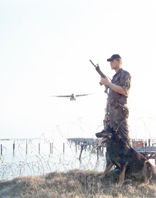 U.S. Air Force dog handlers provided a unique and critical capability in defending air bases against attack. (U.S. Air Force photo).