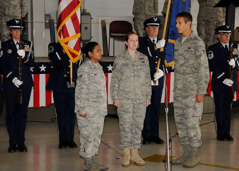 Base Honor Guard presents the colors while the National Anthem is sung by the Racer Trio. Photo by Master Sgt. John Day