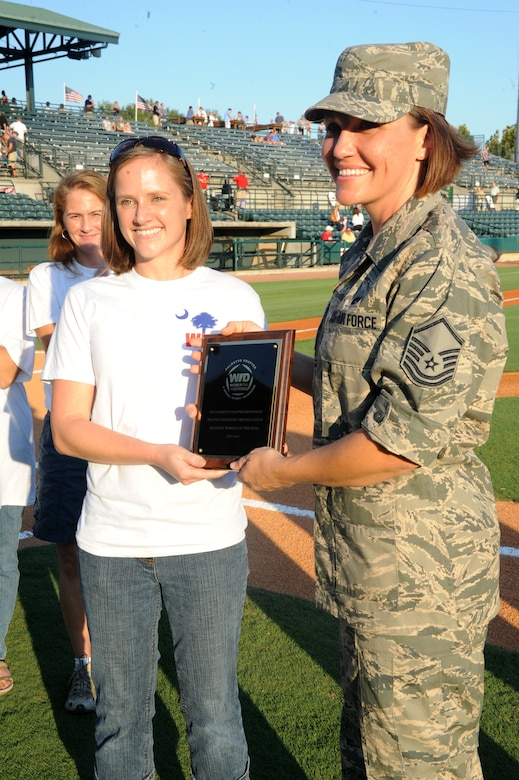 "Master Sergeant Amanda Lynch receives the ""Military Woman of the Year 2011"" award at the Military Appreciation night before the Charleston RiverDogs game Sept.1, at Joe Riley Stadium. The ""Military Woman of the Year 2011"" award was presented by the Women in Defense (a National Security Organization) Palmetto Chapter. (U.S. Air Force photo/Airmen 1st Class Ashlee Galloway)"