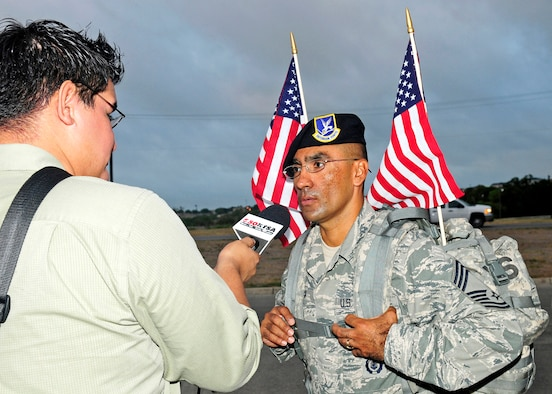 "Chief Master Sgt. Domingo Ortega, the top-ranked senior noncommissioned officer assigned to the Texas Air National Guard's 149th Fighter Wing, discusses ""The Ruck March to Remember 9/11"" with a reporter from San Antonio, Texas, at Lackland Air Force Base, July 12, 2011.