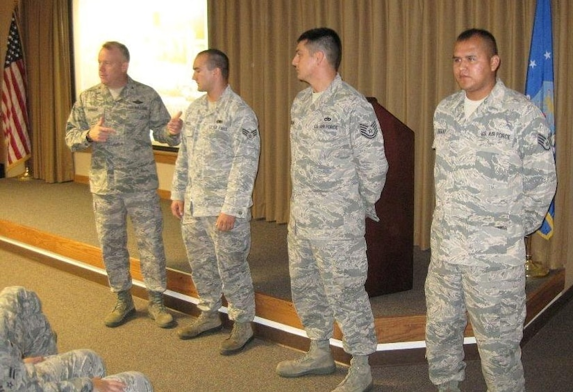 Colonel Erik Hansen recognizes several Airmen at one of his recent Commander's Calls last week at Joint Base Charleston. Hansen conducted 12 Commander's Calls in four days, speaking to 437th Airlift Wing personnel about issues that directly affect them.