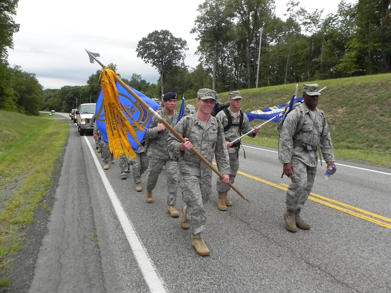 Brig. Gen. Jimmy McMillian, headquarters director of Security Forces, and 2nd Lt. Sean Long, 11th Security Forces Squadron flight commander, lead the way during the Ruck March to Remember.  Team Andrews defenders marched the guidon more than 150 miles from West Virginia to Pennsylvania. (courtesy photo)