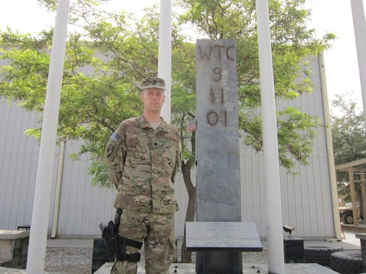 Lt. Col. Jeffrey Head stands in front of a 9-foot beam from the World Trade Center at Bagram Air Field, Afghanistan, recently. The beam was a gift from the people of Breezy Point, N.Y., thanking the men and women deployed to Bagram for their service. Head was a crew commander with the 4th Space Operations Squadron on Sept. 11, 2001. (Courtesy photo)