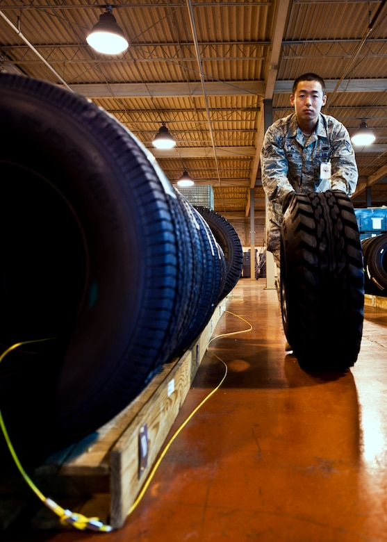 Senior Airman Ching Jen, 96th Materiel Management Flight, moves one of many tires through Eglin's supply warehouse.  Eglin's materiel management flight is the largest supply flight in the U.S.  Approximately 125 military and civilian personnel manage more than 50,000 items valued at $875 million.  They also manage more than 300 nonexpendable equipment accounts tracking more than $700 million in assets spread across Eglin and other locations. The materiel management flight is part of the 96th Logistics Readiness Squadron.  (U.S. Air Force photo/Samuel King Jr.)