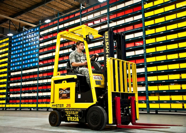 Airman 1st Class Jonathan McGee, 96th Materiel Management Flight, drives a forklift through Eglin's supply warehouse.  Eglin's materiel management flight is the largest supply flight in the U.S.  Approximately 125 military and civilian personnel manage more than 50,000 items valued at $875 million.  They also manage more than 300 nonexpendable equipment accounts tracking more than $700 million in assets spread across Eglin and other locations. The materiel management flight is part of the 96th Logistics Readiness Squadron.  (U.S. Air Force photo/Samuel King Jr.)