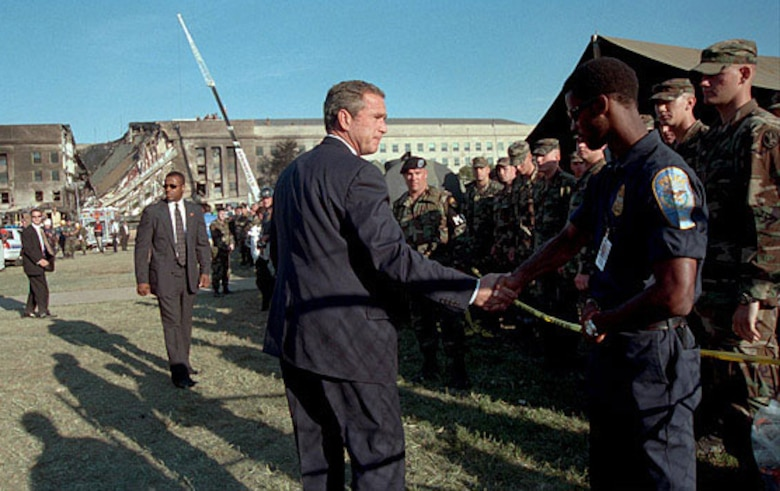 President George W. Bush thanks a first responder for his service outside the Pentagon on Sept. 12, 2001. (U.S. Air Force photo)