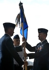 Col. Kirk Smith, 27th Special Operations Wing vice commander, hands the guidon to Col. William West 27th Special Operations Group commander, at Cannon Air force Base, N.M., Sept. 9, 2011. West formally served as the chief of strategy division for the 609th Combined Air and Space Operations Center. (U.S. Air Force photo by Airman 1st Class Ericka Engblom)