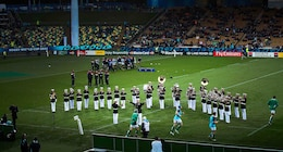 The U.S. Marine Corps Forces, Pacific Band opens the USA versus Ireland match at the Rugby World Cup 2011 in New Plymouth Sept. 11. Chief Warrant Officer 3 Michael Smith,  officer-in-charge, MARFORPAC Band, sings 'Fly like an Eagle' to motivate the American rugby team, who are known as the Eagles.