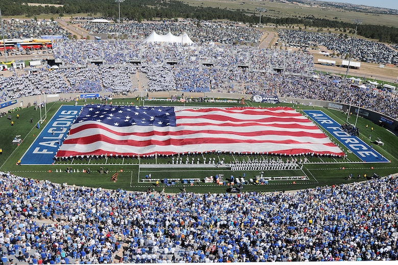 A 300 foot long American Flag is unfurled on the field during halftime activities of the Air Force Falcons' game against the TCU Horned Frogs Sept. 10, 2011 at Falcon Stadium. It was one of many 9/11 commemorative events during the game. (U.S. Air Force photo/Sarah Chambers)