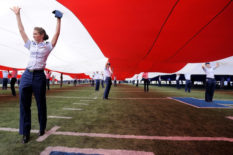 A 300 foot long American Flag is unfurled on the field during halftime activities of the Air Force Falcons' game against the TCU Horned Frogs Sept. 10, 2011 at Falcon Stadium. It was one of many 9/11 commemorative events during the game. (U.S. Air Force photo/Mike Kaplan)