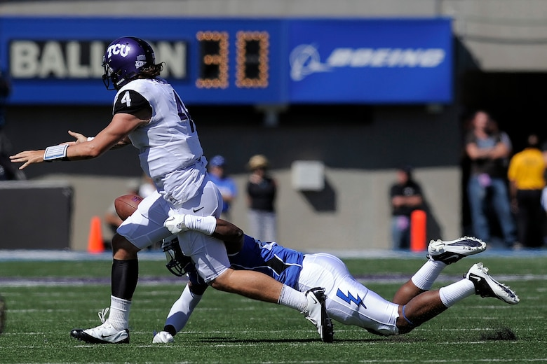 Falcon linebacker Jamil Cooks forces a fumble during a losing effort to the TCU Horned Frogs Sept. 10, 2011 at Falcon Stadium. The Frogs gained more than 400 total yards in what was almost a replay of last year's game in Fort Worth, Texas, and defeated the Falcons, 35-19. (U.S. Air Force photo/Mike Kaplan)