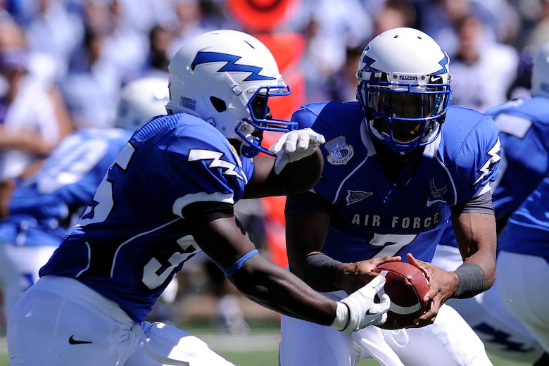 Air Force quarterback Tim Jefferson hands off to running back Wes Cobb during a losing effort to the TCU Horned Frogs Sept. 10, 2011 at Falcon Stadium. In what was almost a replay of last year's game in Fort Worth, Texas, the Horned Frogs handed the Falcons their first loss of the season with a final score of 35-19. (U.S. Air Force photo/Mike Kaplan)