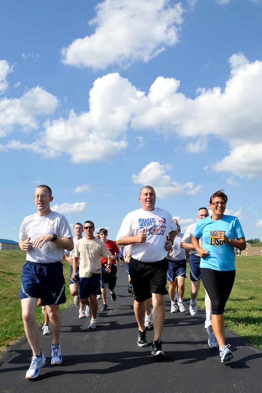 1st Lt. Matt Metzger runs with Kevin and Marci Crozier  during a workout on August 21, 2011 in Fort Wayne, Ind.  Crozier led a workout with members of the 122 FW after giving a motivational speech.  Photo by Staff Sgt. Justin Goeden. UNRELEASED
