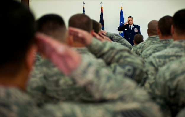 ANDERSEN AIR FORCE BASE, Guam— Lt. Col. Michael Black, 36th Mobility Response Squadron commander, is given a first salute from his troops during the 36th MRS change of command ceremony held at the Sunrise Conference Center here Sep. 7. Each incoming commander is given a first salute after receiving command of the unit. (U.S. Air Force photo by Senior Airman Benjamin Wiseman/Released)