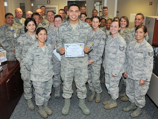 Staff Sgt. Louis Favela, 36th Medical Group noncommissioned officer in charge of education and training, was awarded Team Andersen's Best here, Sept. 8. Andersen's Best is a recognition program which highlights a top performer from the 36th Wing. Each week, supervisors nominate a member of their team for outstanding performance and the wing commander presents the selected Airman/civilian with an award. (U.S. Air Force photo by Staff Sgt. Alexandre Montes)