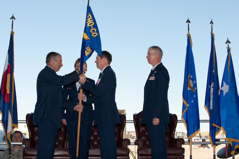 The Adjutant General of Colorado Maj. Gen. H. Michael Edwards passes the Joint Force Headquarters Flag to Brig. Gen. Richard L. Martin in a Change of Command ceremony at Buckley Air Force Base, Colo., Sept. 10, 2011. Martin is assuming command of the Colorado Air National Guard and the position of Assistant Adjutant General - Air. He previously held the position of Director of Operations for the Colorado Air National Guard. (U.S. Air Force photo/Master Sgt. John Nimmo, Sr.) (RELEASED)
