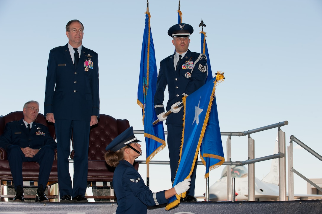 Brig. Gen. Richard L. Martin stands at attention as the 140th Wing Color Guard unfurls his one-star flag during Martin's promotion ceremony at Buckley Air Force Base, Colo., Sept. 10. Martin is assuming command of the Colorado Air National Guard and the position of Assistant Adjutant General - Air. (U.S. Air Force photo/Master Sgt. John Nimmo, Sr.) (RELEASED)