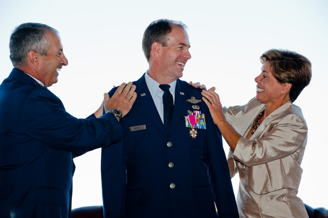 Brig. Gen. Richard L. Martin, Assistant Adjutant General - Air and Colorado Air National Guard Commander, watches his wife Roseann and Adjutant General of Colorado Maj. Gen. H. Michael Edwards attach his new rank to his dress uniform Sept. 10, 2011 Buckley Air Force Base, CO. (U.S. Air Force photo/Master Sgt. John Nimmo, Sr.) (RELEASED)