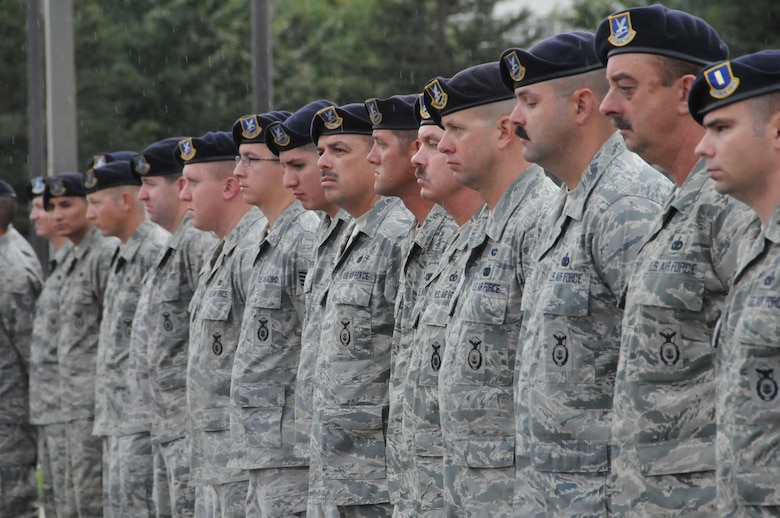Members of the 144th Security Forces Squadron, 144 Fighter Wing, California Air National Guard, Fresno Calif., pause to honor those who served, perished and paid the ultimate sacrifice during a remembrance ceremony on Sept. 11, 2011. The ceremony included time to ponder our great losses, an invocation from the base chaplain, a 21 gun salute and a display of military and civilian emergency vehicles. (U.S. Air Force photo by MSgt David Loeffler)