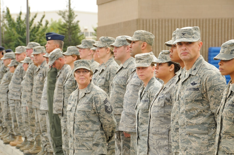 Col. Sami Said, Commander of the 144th Fighter Wing, California Air National Guard, Fresno Calif., pauses to honor those who served, perished and paid the ultimate sacrifice during a ceremony Sept. 11, 2011. The ceremony included time to ponder our great losses, an invocation from the base chaplain, a 21 gun salute and a display of military and civilian emergency vehicles. (U.S. Air Force photo by Tech. Sgt Robin D. Meredith)