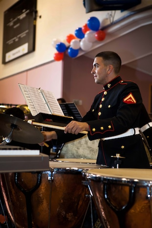 Lance Cpl. Daniel Chunn, percussionist, U.S. Marine Corps Forces, Pacific Band, alternates playing the tympani and the cymbals during a concert held at the Stratford War Memorial Centre here Sept 13. The concert was held for the Stratford community to celebrate the 70th anniversary of Marines landing in Wellington in 1942. (Official U.S. Marine Corps photo by Lance Cpl. Isis M. Ramirez)