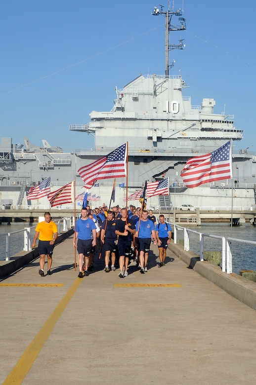 More than 200 chiefs and chief selects from Joint Base Charleston-Weapons Station participate in the 10th annual Heritage run at Patriot's Point, Sept. 10. The heritage run made stops at five different monuments, one being the USS Yorktown (CV 10) giving the history and significance of its role during its commission. The heritage run is designed to unite chiefs and chief selects, exemplify Navy core values of Honor, Courage and Commitment and teach chiefs about our naval heritage. (U.S. Navy photo/Mass Communication Specialist 1st Class Jennifer Hudson)
