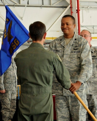 Lt. Col. Jeffery Richard (right), incoming 129th Rescue Wing Mission Support Group Commander, receives the MSG guidon from Col. Steven J. Butow, 129th Rescue Wing Commander, during the 129th MSG change of command ceremony at Moffett Federal Airfield, Calif., Sept. 10, 2011. (Air National Guard photo by Staff Sgt. Kim Ramirez)