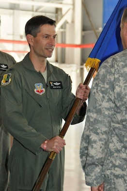 Col. Steven J. Butow, incoming 129th Rescue Wing Commander, receives the wing guidon from Maj. Gen. David S. Baldwin, The Adjutant General of the California National Guard, during the wing's change of command ceremony at Moffett Federal Airfield, Calif., Sept. 10, 2011. Butow formerly served as the wing's vice commander. (Air National Guard photo by Staff Sgt. Kim Ramirez)