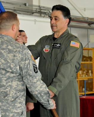 Col. Amos Bagdasarian (right), outgoing 129th Rescue Wing Commander, relinquishes the wing guidon to Maj. Gen. David S. Baldwin, The Adjutant General of the California National Guard, during the wing's change of command ceremony at Moffett Federal Airfield, Calif., Sept. 10, 2011. Bagdasarian served as 129th RQW Commander from 2005 to 2011. (Air National Guard photo by Staff Sgt. Kim Ramirez)