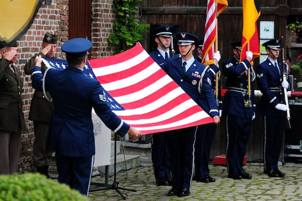 BORLO, Belgium – 52nd Fighter Wing Honor Guard members Staff Sgt. Victor Estupinan, left, and Staff Sgt. Charles Lopez perform a flag-folding ceremony during a Belgian 9-11 memorial here Sept. 11 U.S. service members and Belgian World War II Honor Guard Team members, along with the local community, participated in this ceremony as part of the Belgian Open Monument Day in remembrance of the victims of the Sept. 11, 2001 terrorist attacks on the United States. (U.S. Air Force photo/Airman 1st Class Matthew B. Fredericks)