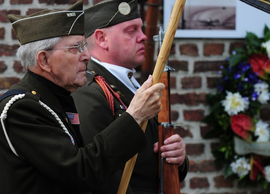 BORLO, Belgium – Maurice Sperandieu, a Belgian World War II veteran, left, and Frank De Rudder, World War II Honor Guard commander, stand at attention during a Belgian 9-11 memorial ceremony here Sept. 11. U.S. service members and Belgian World War II Honor Guard Team members, along with the local community, participated in this ceremony as part of the Belgian Open Monument Day in remembrance of the victims of the Sept. 11, 2001 terrorist attacks on the United States. (U.S. Air Force photo/Airman 1st Class Matthew B. Fredericks)