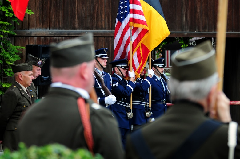 BORLO, Belgium – 52nd Fighter Wing Honor Guard members stand at attention before posting the colors during a 9-11 memorial ceremony here Sept. 11. U.S. service members and Belgian World War II Honor Guard Team members, along with the local community, participated in this ceremony as part of the Belgian Open Monument Day in remembrance of the victims of the Sept. 11, 2001 terrorist attacks on the United States. (U.S. Air Force photo/Airman 1st Class Matthew B. Fredericks)