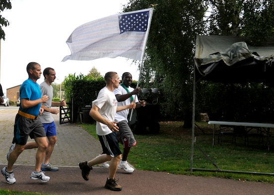 ROYAL AIR FORCE LAKENHEATH, England - Liberty Warriors run the trail at Peacekeeper Park during the 24-hour Memorial Run, Sept. 10, 2011. The run, in remembrance in those that lost their lives in the 9/11 attacks, ended at 1:46 p.m. on Sept. 11, 2011, the time the first tower was hit. (U.S. Air Force photo by Senior Airman Tiffany M. Deuel)