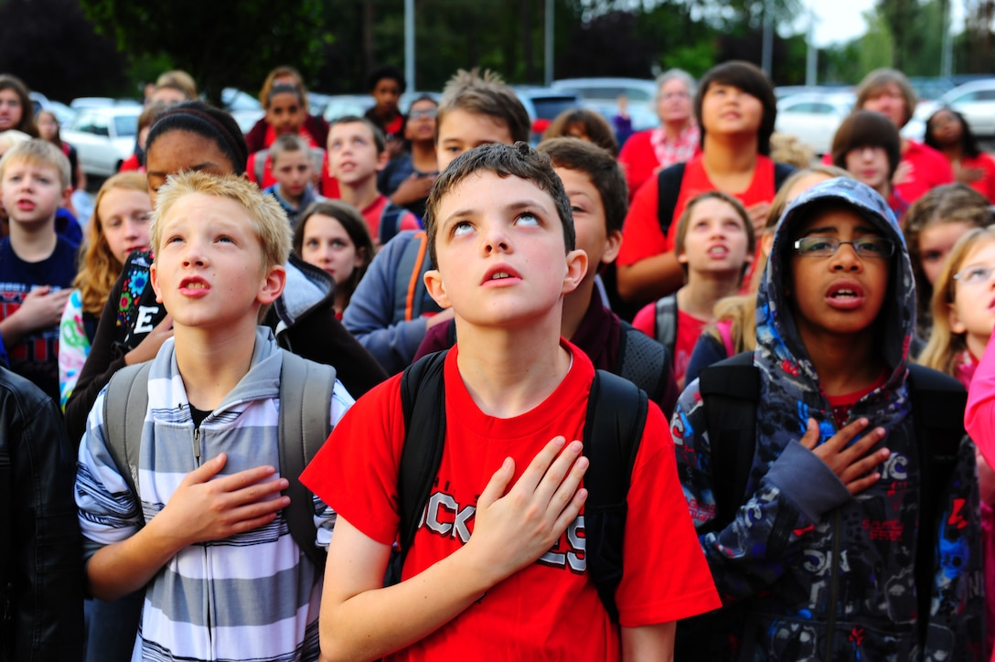 Students from Ramstein Middle School resite the Pledge of Allegiance during a Sep. 11 commemoration ceremony, Ramstein Air Base, Germany, Sep. 9, 2011. This year marks the 10th anniversary of the terrorist attacks on Sept. 11, 2001. (U.S. Air Force photo by Airman 1st Class Brea Miller)