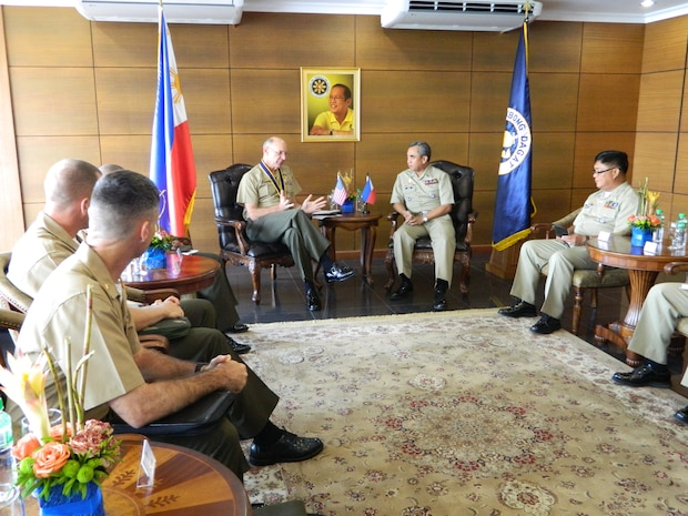 Lt. Gen. Duane D. Thiessen, left center, commander of U.S. Marine Corps Forces, Pacific, meets with Adm. Alexander Pama, flag officer in command of the Philippine Navy, and principal staff during a visit to the Philippine Navy headquarters, Sept. 14. Thiessen visited the Philippines to meet with the U.S. ambassador, U.S. and Filipino military officials, and component commanders from the Armed Forces of the Philippines.