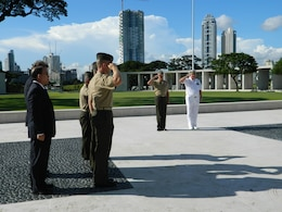 Lt. Gen. Duane D. Thiessen, center, commander of U.S. Marine Corps Forces, Pacific, along with U.S. personnel, renders honors during the playing of taps at the American Battle Monument and Cemetery in Metropolitan Manila, Sept. 14. Thiessen laid a wreath at the base of the monument in memory of U.S. and Philippine service members who made the ultimate sacrifice in service to their countries. Thiessen visited the Philippines from Sept. 13 – 17. During his visit, Thiessen met with the U.S. ambassador, U.S. and Filipino military officials, and component commanders from the Armed Forces of the Philippines.