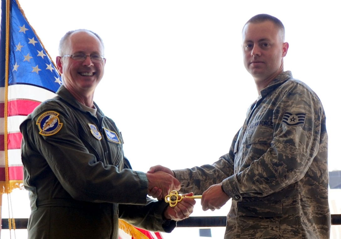 DYESS AIR FORCE BASE, Texas - Lt. Gen. Robert R. Allardice, Commander, 18th Air Force, presents a ceremonial key for the 317th Airlift Group's newest C-130J to dedicated crew chief Staff Sgt. Michael Smith here Sept. 8. The delivery was the sixth in the 317th's continuing transition to the new aircraft. Dyess is slated to become home to the Air Force's largest C-130J fleet when it receives its 28th and final C-130J in 2013.