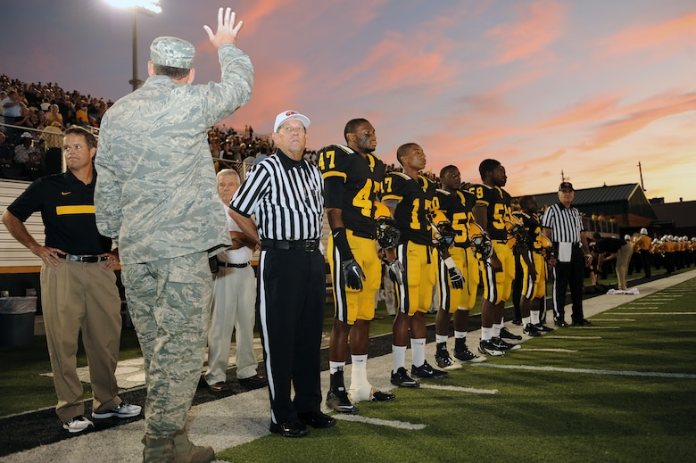 U.S. Air Force Col. Scott Kindsvater, 93rd Air Ground Operations Wing commander, waves at Valdosta High school football fans at Cleveland Field, Valdosta, Ga., Sept. 9, 2011. Kindsvater was the special guest of honor for military appreciation night, which allowed military members and their families free entry to the game (U.S. Air Force photo by Senior Airman Ciara Wymbs/Released)